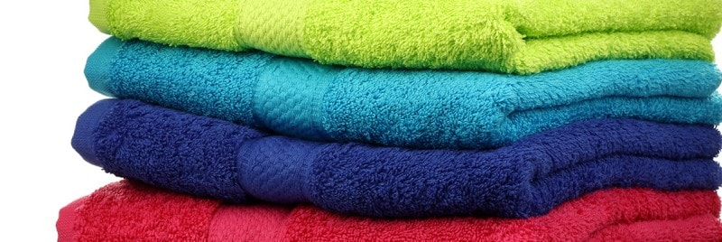 Colourful towels folded and stacked up.