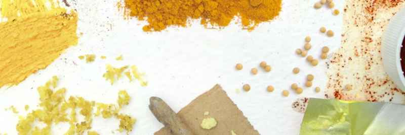 A general image of foods and spices set out on a white table.