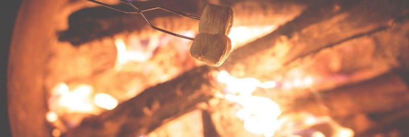 Marshmallows being roasted over a bonfire.