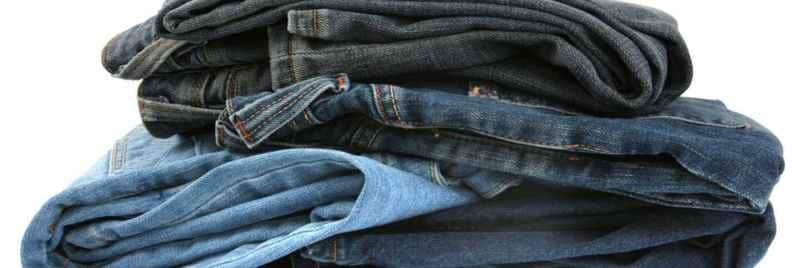 A pile of folded denim jeans.