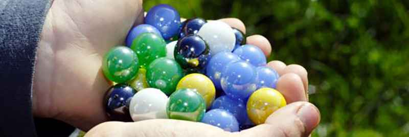 An assortment of marbles being held.