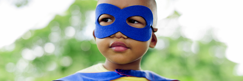 A child in a blue superhero mask.